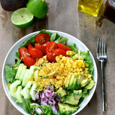 GUCAMOLE GREENS SALAD WITH SEASONED CORN AND CUCUMBERS