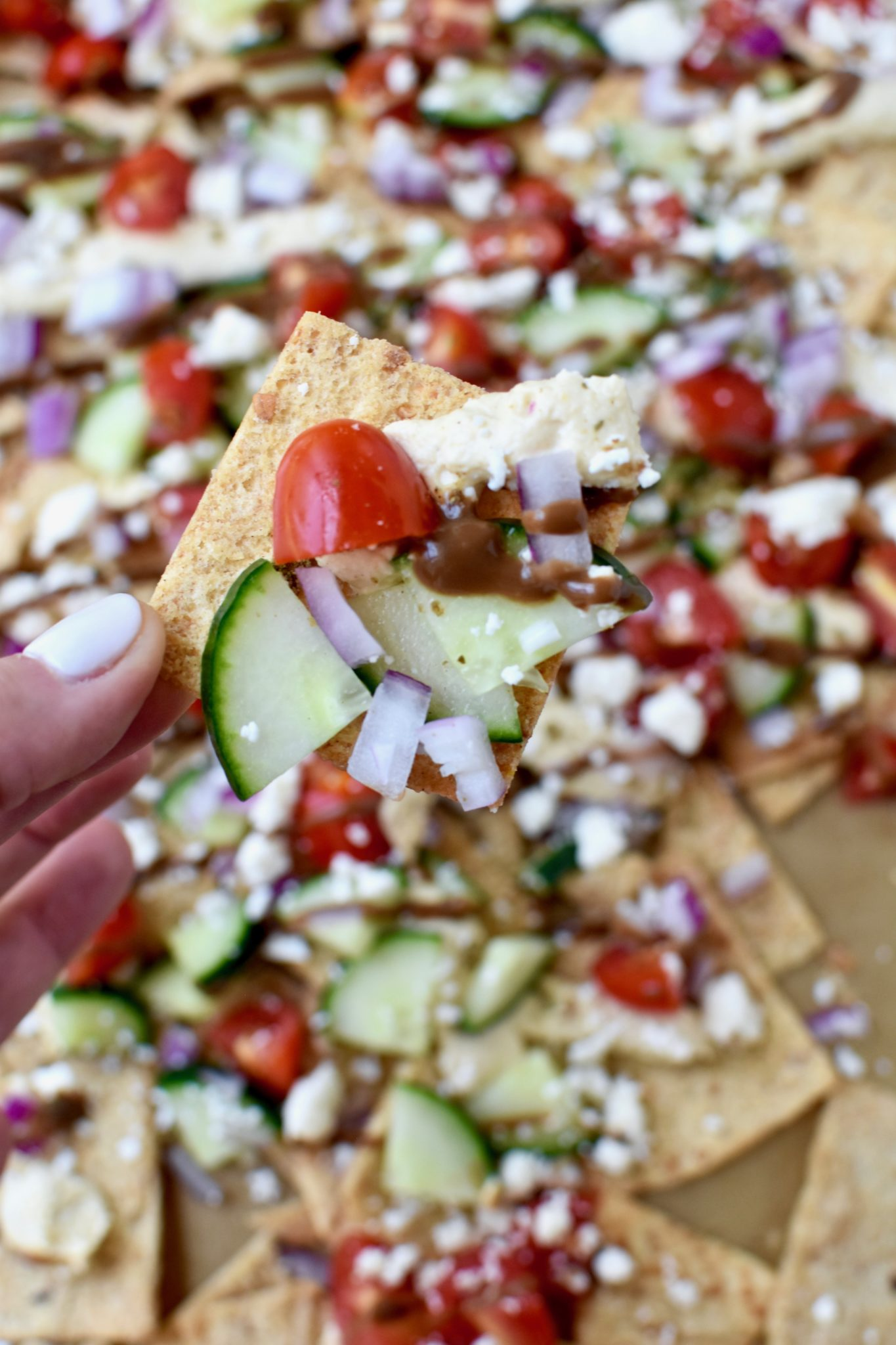greek pita chip nachos - a quick and easy meal solution everyone will love! // cait's plate