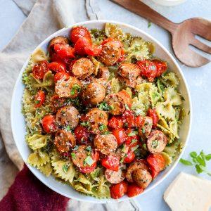 arugula pesto pasta with caprese chicken sausage // cait's plate