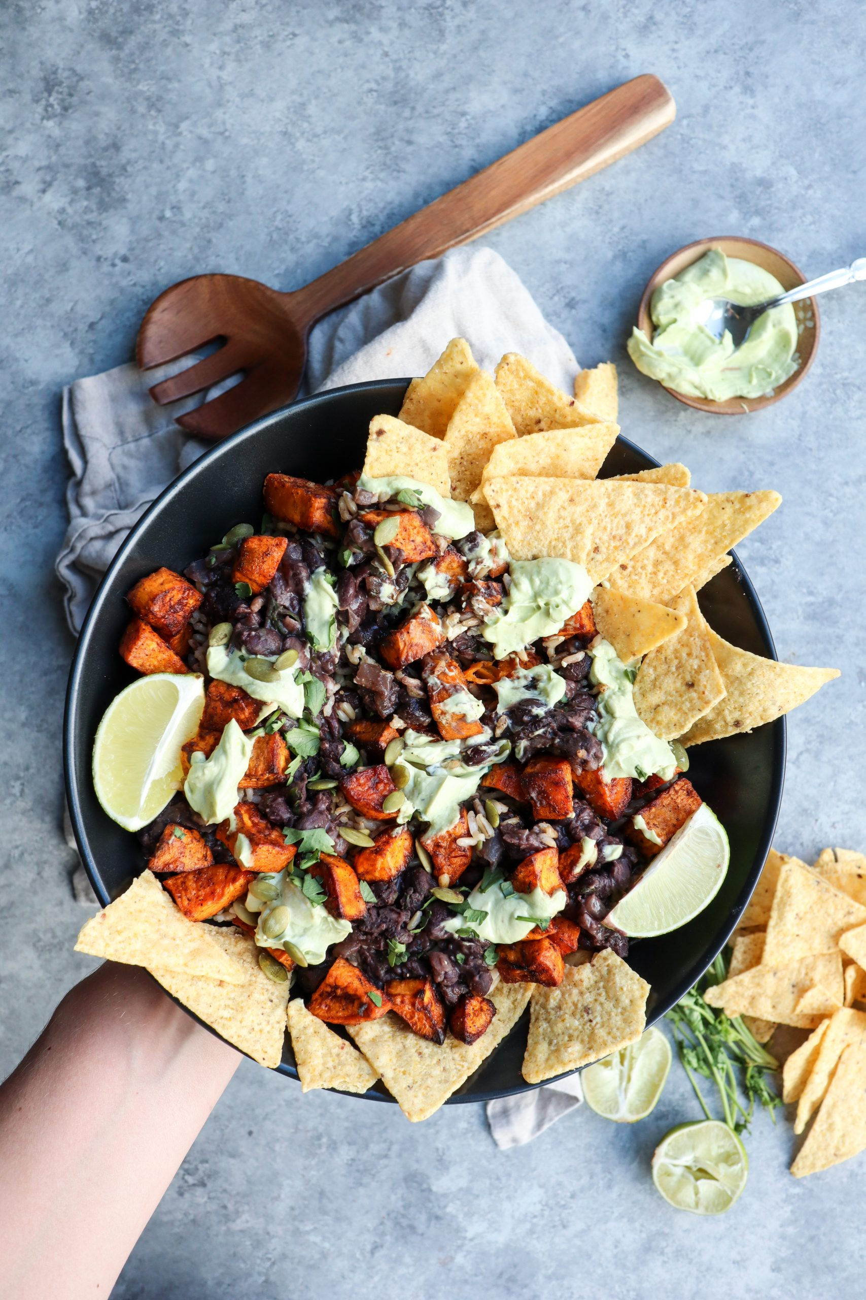 spiced sweet potato & creamy black beans bowl with lime avocado yogurt sauce // cait's plate